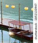 Wooden Pier With Old Boats And...