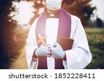 Man Priest With A Cross In A...