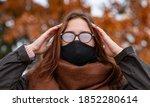 The woman wears a black mask...