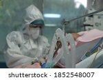 Small photo of A patient is seen in the intensive care unit for the coronavirus disease (COVID-19) in Thoracic Diseases Hospital of Athens in Greece on November 8, 2020.