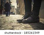 legs of a person wearing black... | Shutterstock . vector #185261549