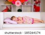 sweet little girl sleeping on... | Shutterstock . vector #185264174