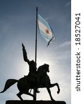 Statue of Dr. Manuel Belgrano (1770-1820), Argentinian hero, and Argentinian flag on the Plaza De Mayo in Buenos Aires - stock photo