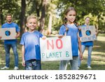 Children Holding Placard With...