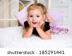 happy laughing girl  on a bed  | Shutterstock . vector #185291441