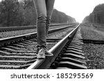 Girl Walking Across Railroad. ...