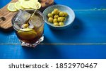 Small photo of typical Spanish aperitif, with verbose, olives and chips with pepper and lemon