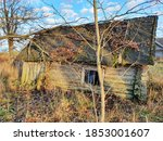 Ancient Crumbling Log Cabin In...