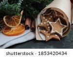 cookies in a paper bag with fir ... | Shutterstock . vector #1853420434