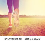 an athletic pair of legs on... | Shutterstock . vector #185361629