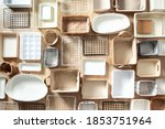 Small photo of Flat lay of Marie Kondo's storage boxes, containers and baskets with different sizes and shapes for tidying up wardrobe. KonMari method organizer boxes set. Closet organizing concept.