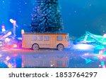 Miniature Yellow Bus And Fir...