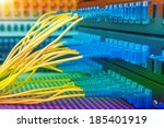 Panel of Fiber network switch with some yellow optical network cables - stock photo