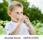 child drinking pure water in... | Shutterstock . vector #185411054