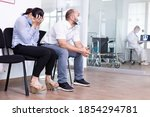 Small photo of Woman and her husband crying in hospital waiting room. Medical staff giving unfavorable test results. Stressed man and woman during medic appointment.