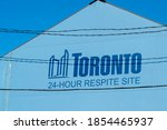 Small photo of Toronto, Canada- November 14, 2020: A 24-Hour Respite Site sign is seen in Toronto, Canada. The Respite Site provides essential services to individuals experiencing homelessness.