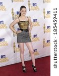 Постер, плакат: Kristen Stewart wearing a