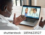 Small photo of Multicultural doctors team conferencing in video call chat discussing health care learning online during web seminar. Group medical webinar training, healthcare elearning videoconference concept.