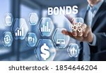 Small photo of Corporate Bonds concept. Man presses his finger on the inscription Bonds.
