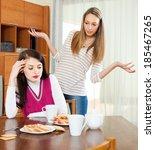 two women having quarrel over... | Shutterstock . vector #185467265