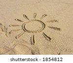 Finger drawn sun on sand - stock photo