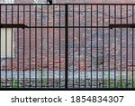 Iron Gate Grating Against A Red ...