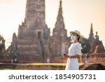 Happy Tourist Woman Wearing...