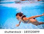 beautiful girl in the pool | Shutterstock . vector #185520899
