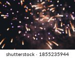Small photo of Abstract photo of fireworks. Salute without focus. Blurry photo of fireworks. Festive fireworks. A beautiful flicker of fireworks. Selective focus.