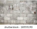 Dirty gray breeze blocks wall background. - stock photo