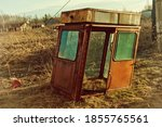 Small photo of View of an old abandoned trailer in the countryside. An image of decrepitude or natural disaster.