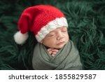 Adorable Newborn In Santa Hat