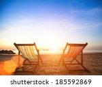Couple Of Beach Chairs On Sea...