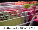 hanging washed colorful clothes ... | Shutterstock . vector #1856012281