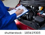 midsection of mechanic holding... | Shutterstock . vector #185619305