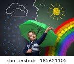 child holding an umbrella... | Shutterstock . vector #185621105