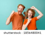 Young Excited Redhead Couple...