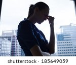 depressed woman in the office. | Shutterstock . vector #185649059