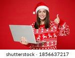 Smiling Young Santa Woman...