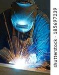 welder working with electrode...   Shutterstock . vector #185697239