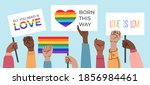 crowd of people holding posters ... | Shutterstock .eps vector #1856984461