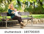 Mother Sitting On A Park Bench...