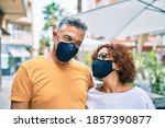 middle age couple wearing... | Shutterstock . vector #1857390877