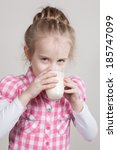 kid girl drinking yogurt or... | Shutterstock . vector #185747099