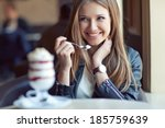 Young Beautiful Woman Eating A...