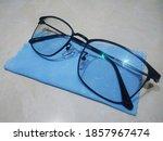 Eyeglass On A Blue Cloth And...