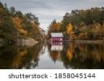 Boathouse Next To A Lake On An...
