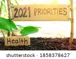 Small photo of 2021 priorities banner in natural background. New Year 2021 setting health as priority and goal concept.