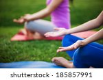 couple doing yoga outdoors | Shutterstock . vector #185857991