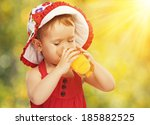 Baby Girl Drinking Orange Juic...